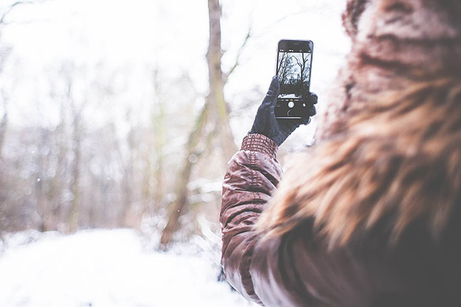Girl shooting with her iPhone 6 in Winter