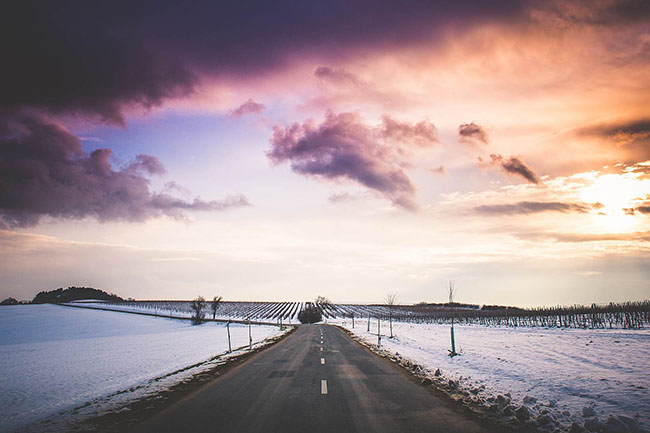 long road with colorful sunset