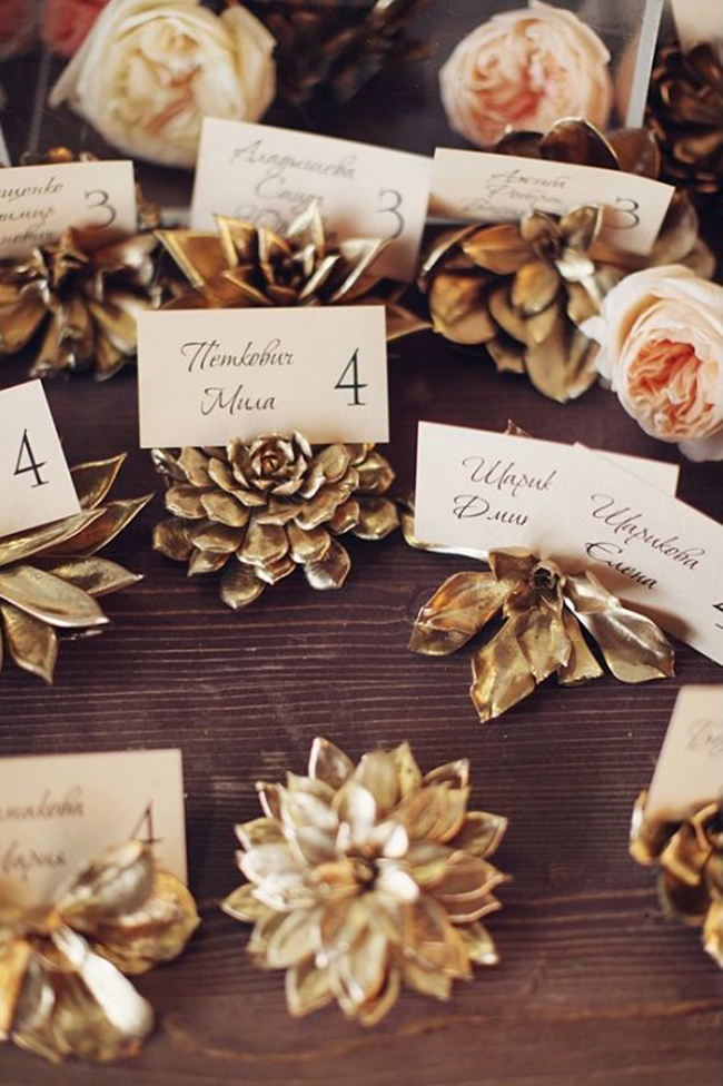 Succulent-escort-card-holders-that-are-spray-painted-gold