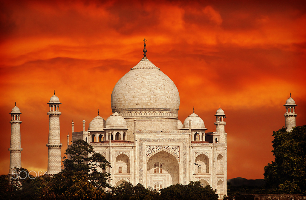 Retro filtered sunset over Taj Mahal, India.