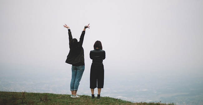 two girl enjoying landscape