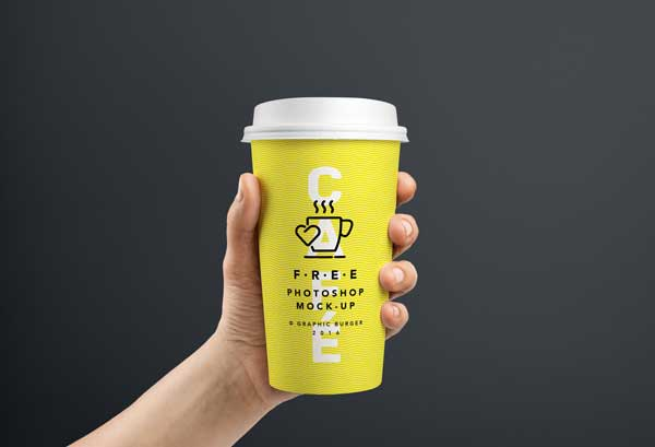 free-psd-coffee-cup-in-hand-mockup-template